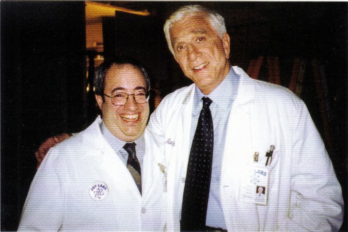 Jeff Eigen and Leslie Nielsen on the set of a Medicare commercial.  Leslie Nielsen started his career as a serious dramatic actor, but when he appeared in the movie, Airplane, his comic career took off.  He played a prank on me in this picture above while he was squeezing his whoopee cushion.  I will never forget the fun experience of working with Leslie Nielsen.  He was truly a great actor.